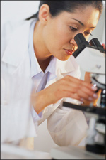 Image of scientist with microscope.